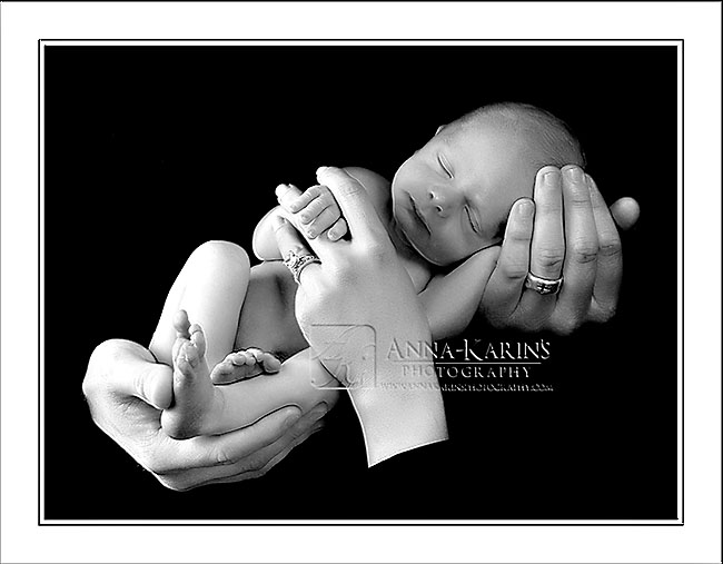 Newborn Baby Boy in his parents arms, Curled up Newborn Baby, BW infant newborn photographs