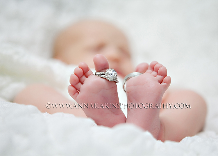 Newborn baby feet with rings