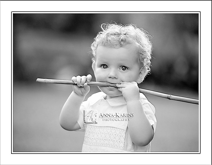 little boy with stick in his mouth, classic bw child hood photograph, Baton Rouge Twin photographer,