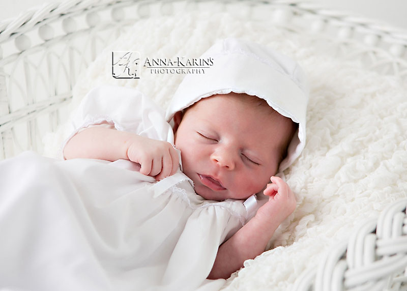 Baby boy in Christening gown, newborn baptized baby