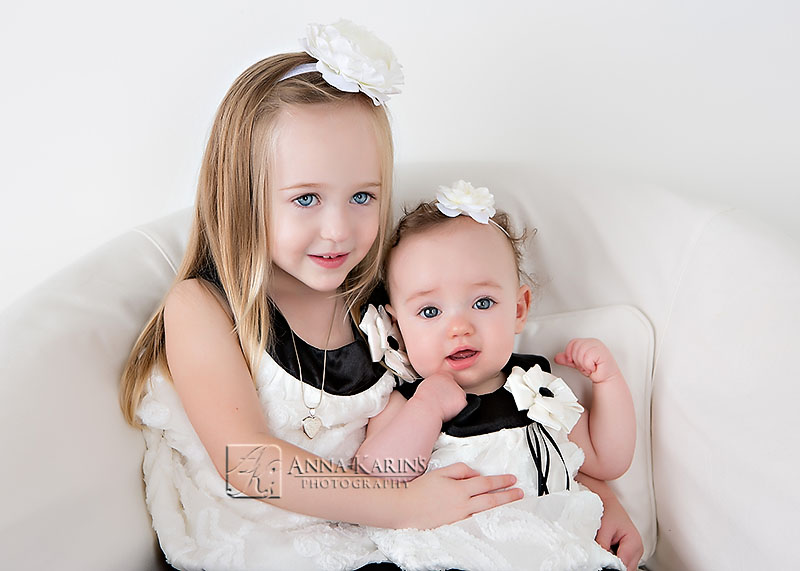 Blue eyed little sisters, beautiful little girls photographed on white, timeless modern portraits of children