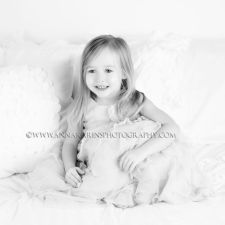 happy joyous beautiful little girl. timeless black and white portrait or little girl with long hair