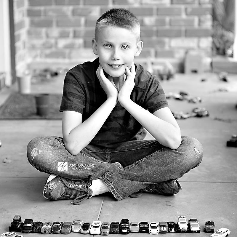 Hotwheel playing boy, toy car collector,
