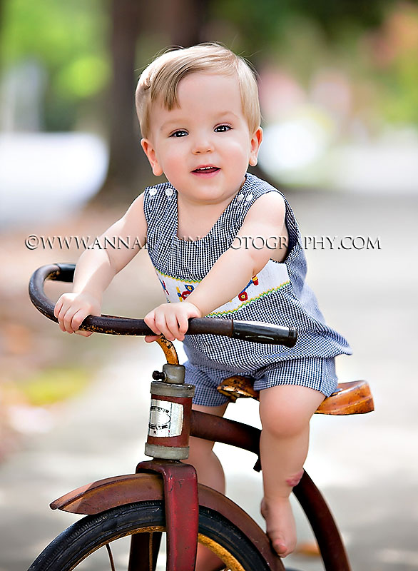 little premie baby now active toddler, toddler boy riding on rusty trike