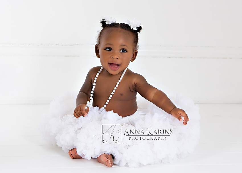 Beautiful baby girl in tutu, baby girl with pearls