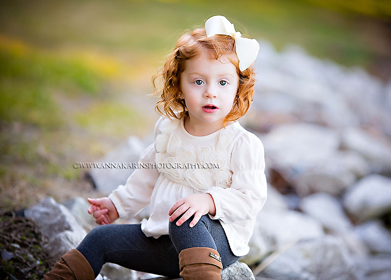 beautiful serious little red haired girl