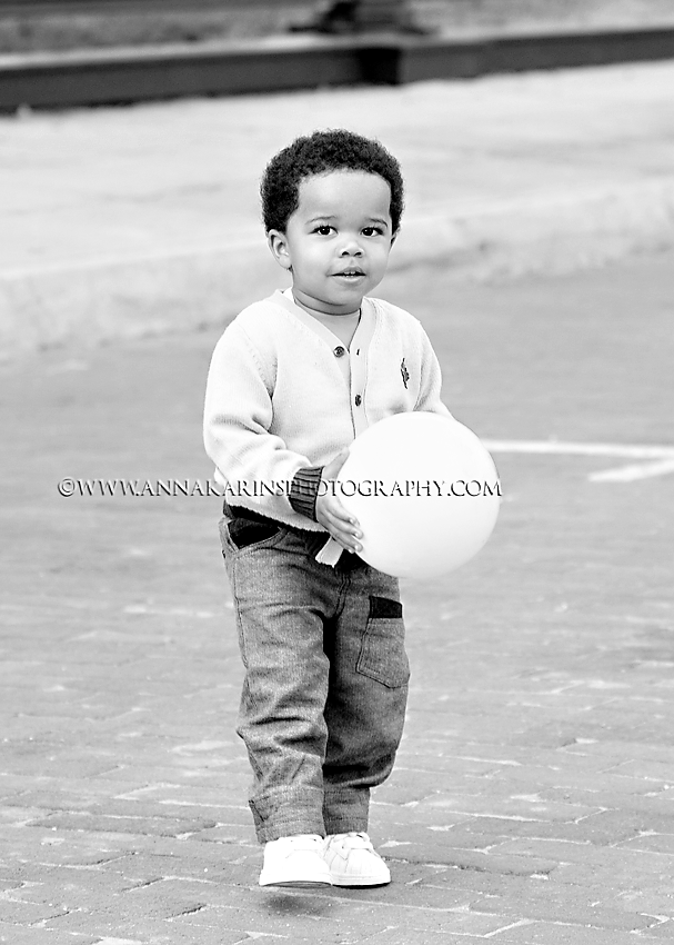 Little boy playing with a boll