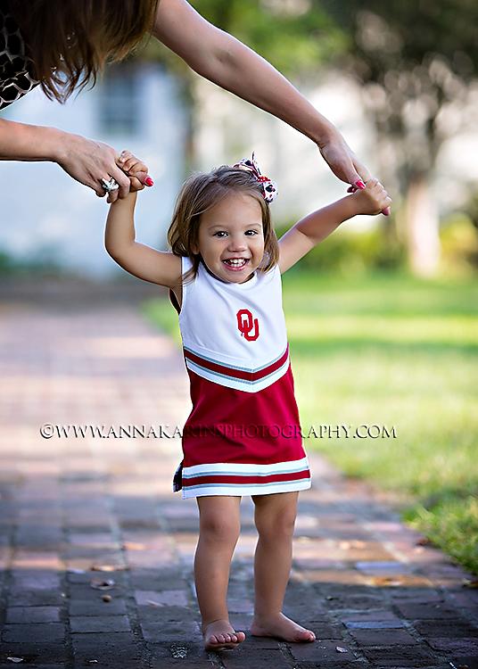 Oklahoma University Cheer leader, Little cheerleader, happy girl holding her mothers hands