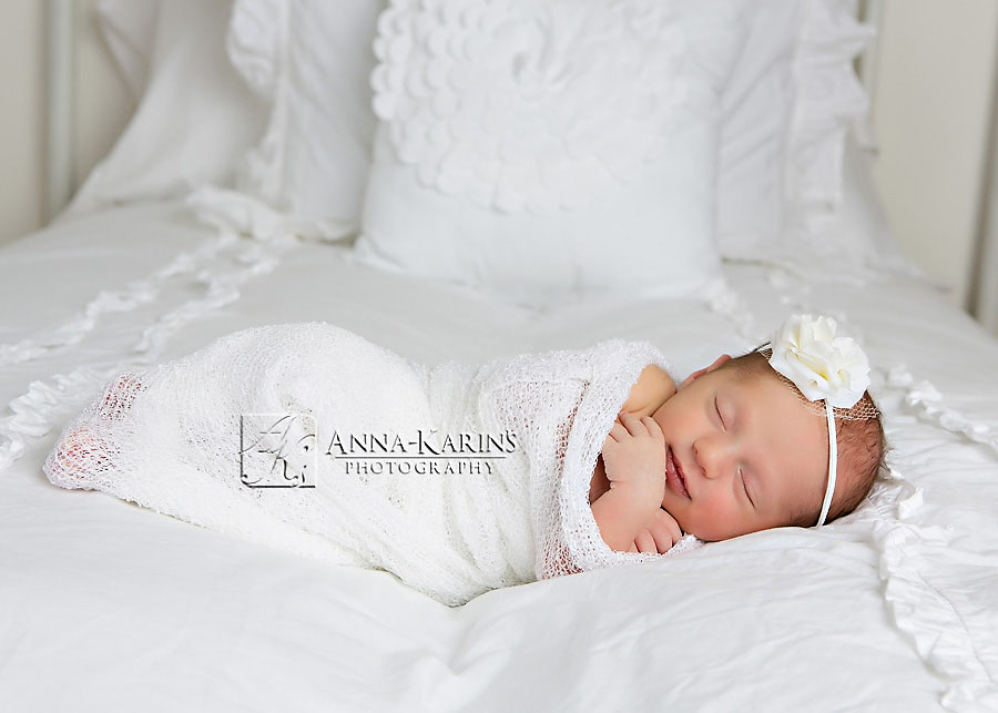 Pretty newborn baby girl, sleepy newborn baby