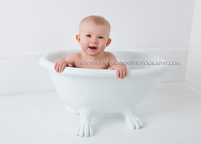 Elegant Happy Blue Eyed Baby Girl In A Clawfoot Baby Bathtub