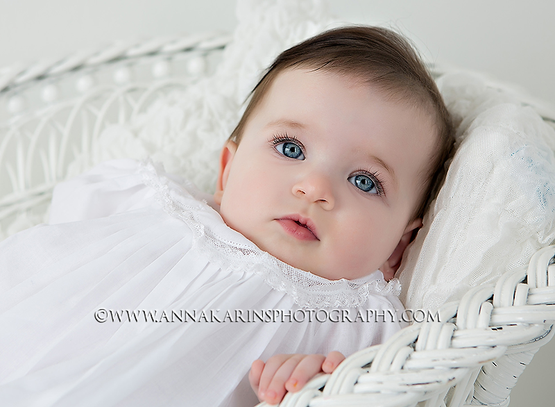 Beautiful baby girl in Christening gown