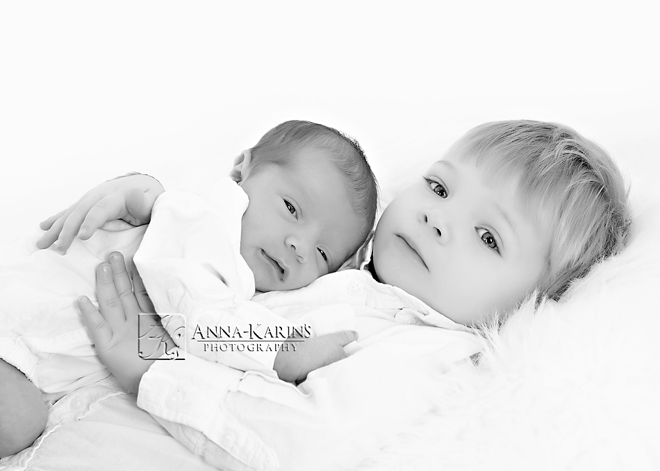 Brothers, newborn baby with big brother