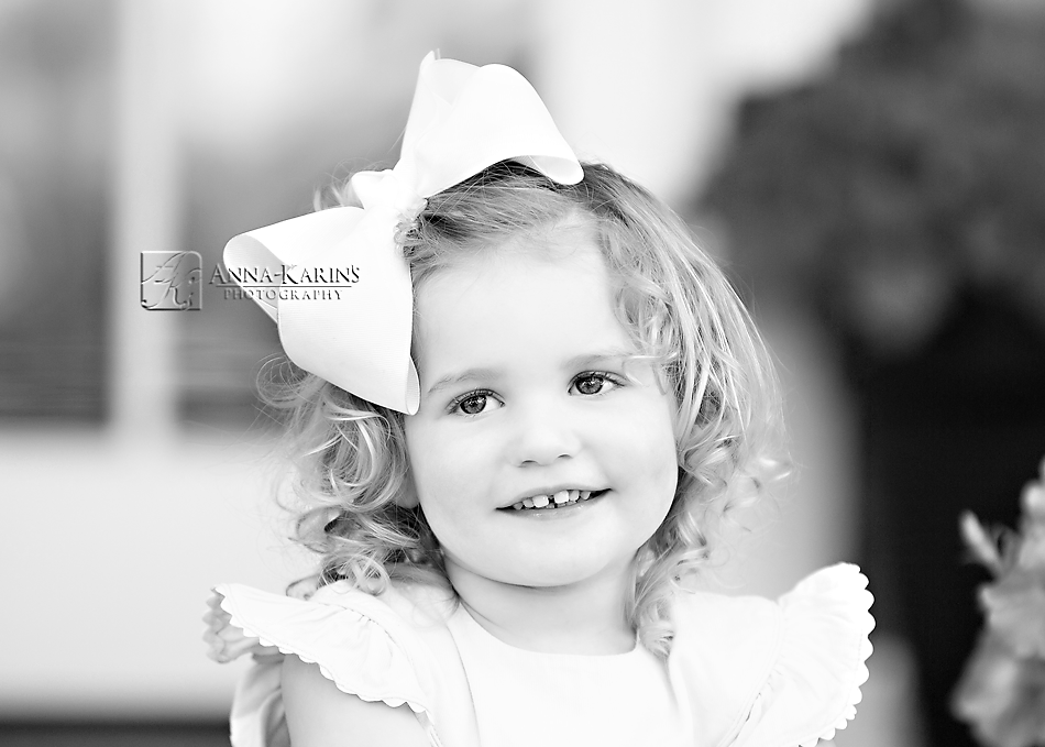 Sweet girl with bow and curly hair