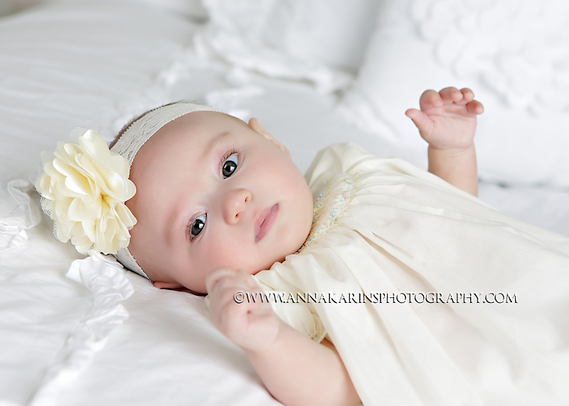 Baby girl in smocked dress on lace