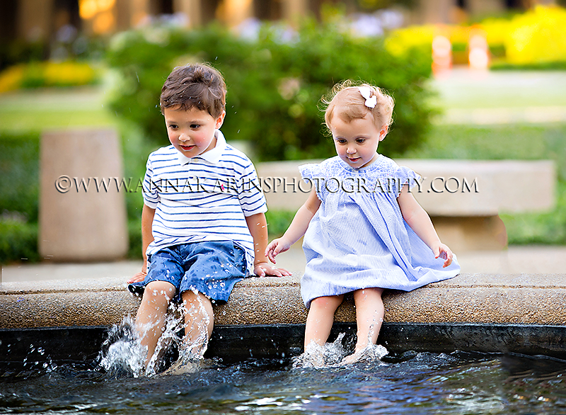 Children playing in a fountain, playful brother and sister, LSU photo session