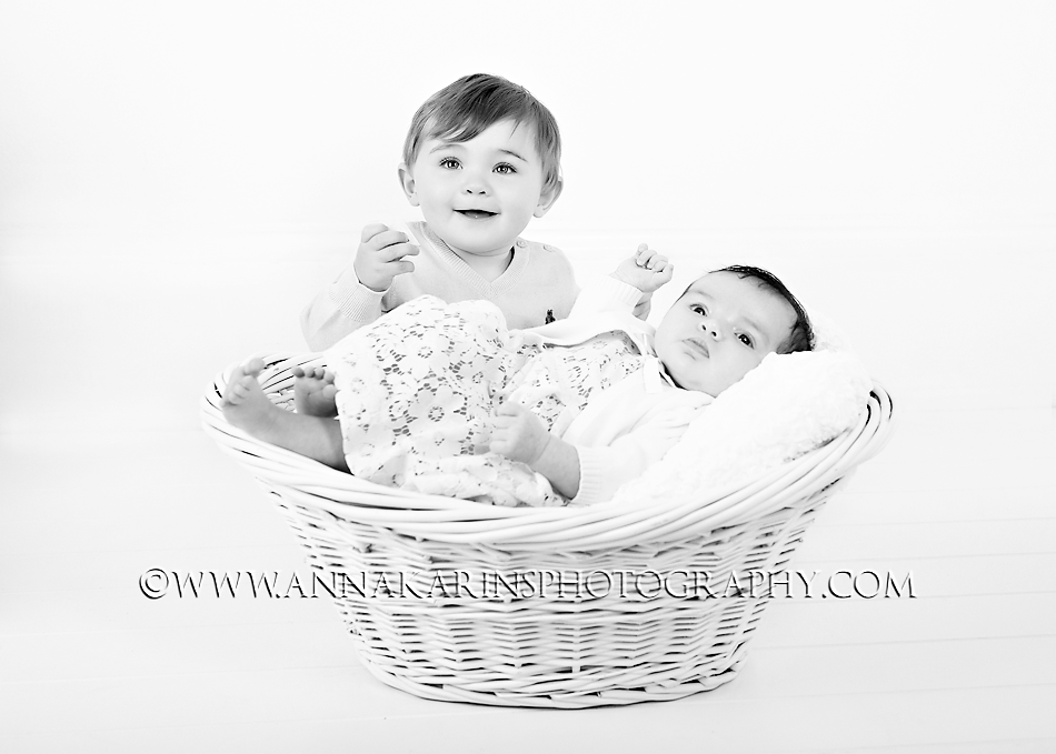 Black and white portrait of two young siblings