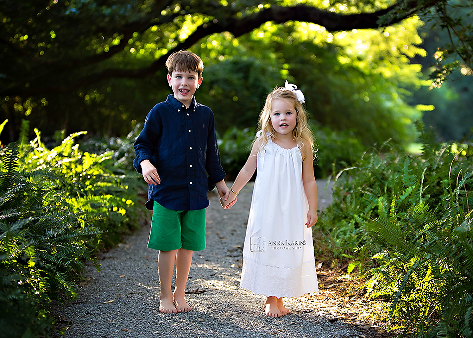 Beautiful and timeless sibling portrait of brother and sister under oak trees in South Louisiana