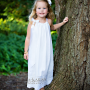 beautiful blong little girl in white pillowcase dress , smocked dress