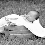 Newborn baby in a basket outside