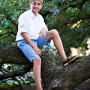 teen boy climbing tree