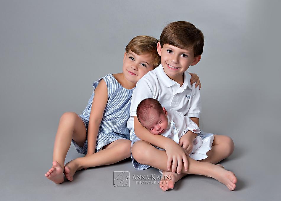 Three brothers, beautiful newborn sibling portrait