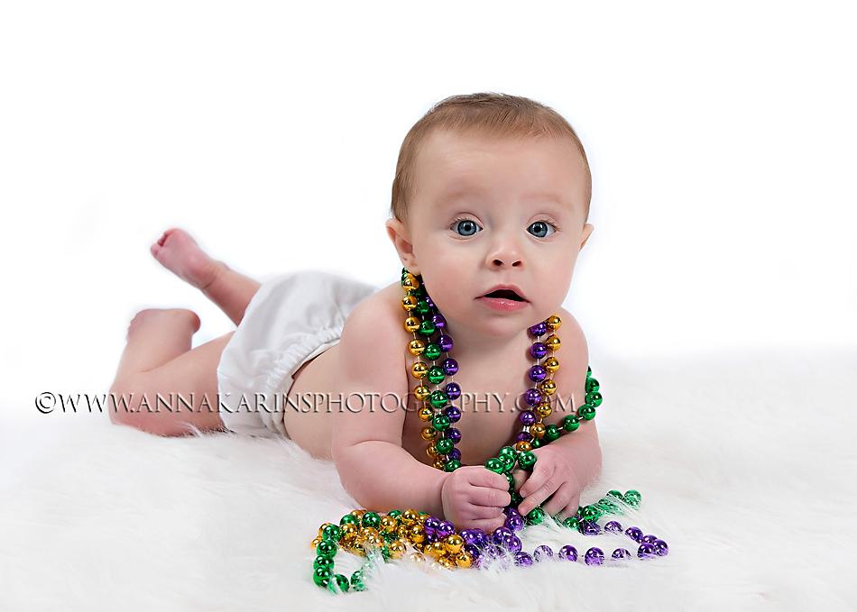 Baby with Mardi Gras Beads