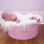 newborn baby girl in pink hat box