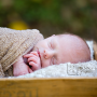 newborn baby outside in a wooden box