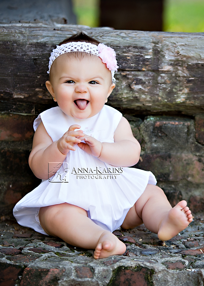Sweet and silly little girl, outdoor baby girl portrait