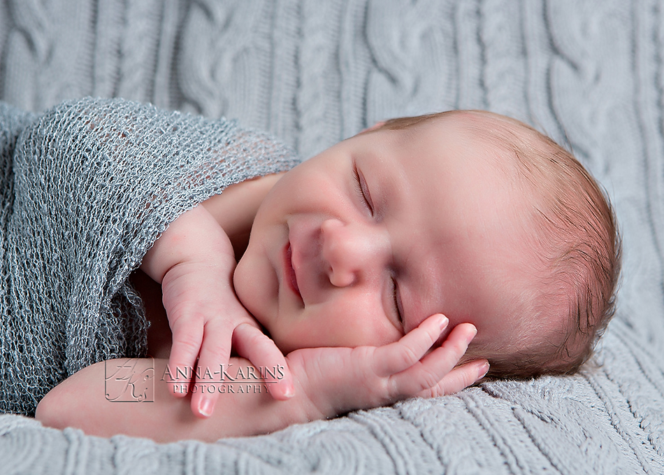 sleepy newborn baby boy, wrapped up baby boy