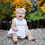baby girl by fall flowers