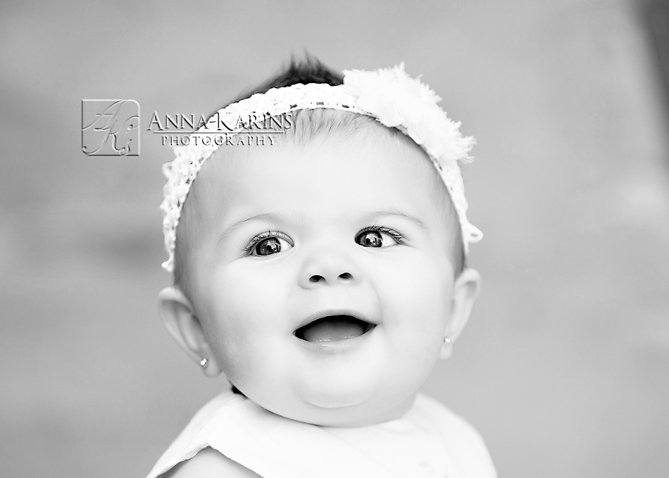 bw portrait of happy smiling baby girl