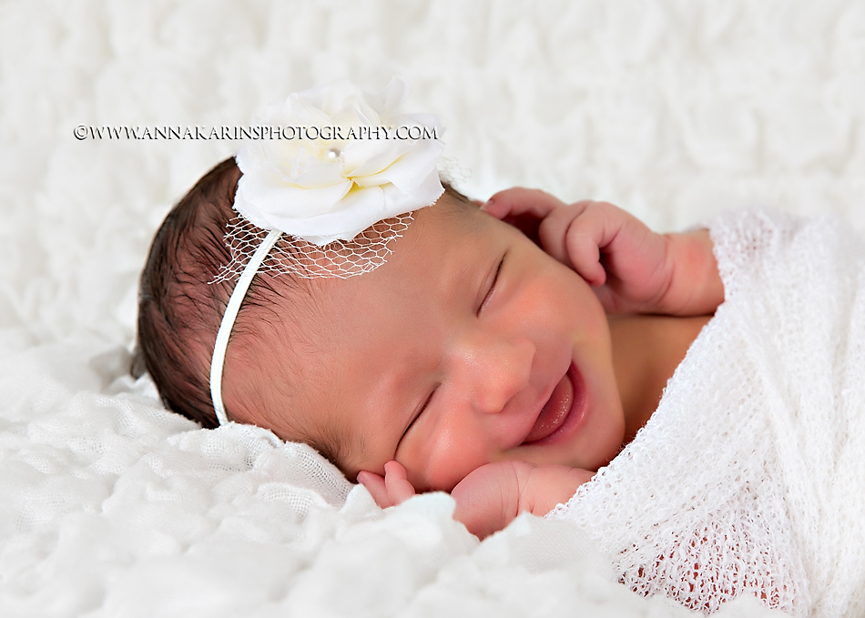 Happy smiling newborn baby girl