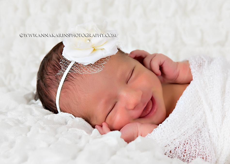happy smiling newborn baby girl