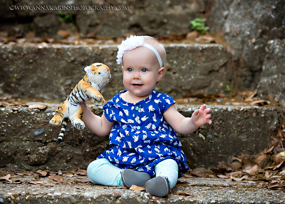 Little girl with a plush Mike the Tiger