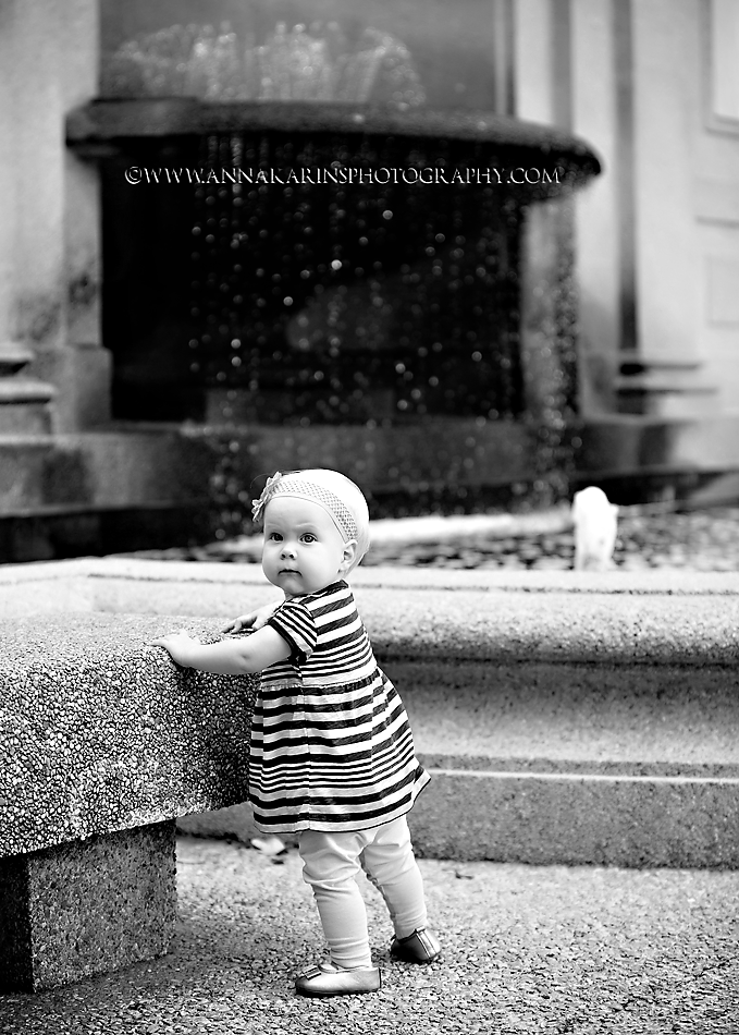 Little girl by fountain